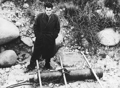 Photo of Jack Parsons with a solid-fuel engine prototype.